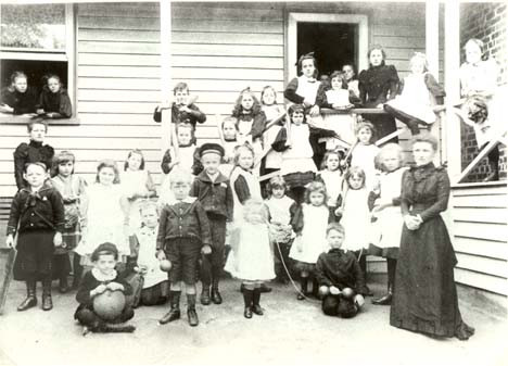 Jeannie Gunn (far left) with her sisters and their students at 'Rolyat Ladies' College', circa 1889. Source: Hawthorn Library.