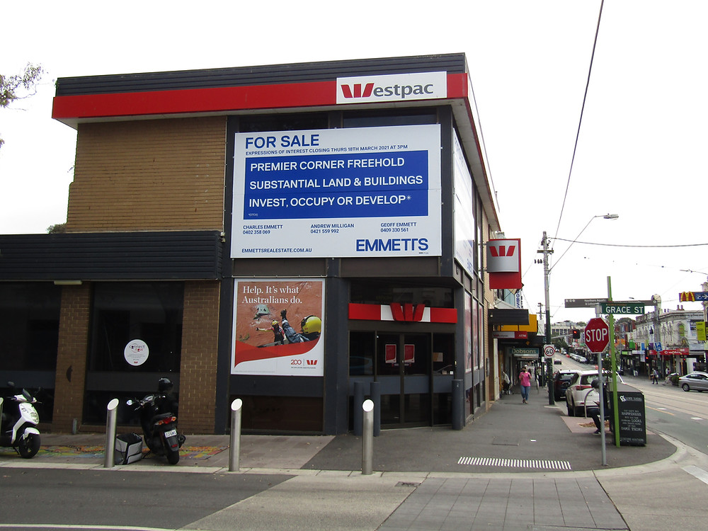 """The Westpac building at 665 Glenferrie Road. Sign: """"FOR SALE: Premier corner freehold, substantial land & buildings, invest, occupy or develop"""" by Emmetts Real Estate."""
