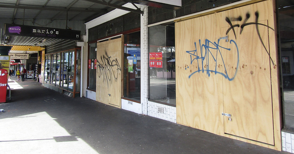 Vacant, boarded-up shops at 664 and 666 Glenferrie Road.