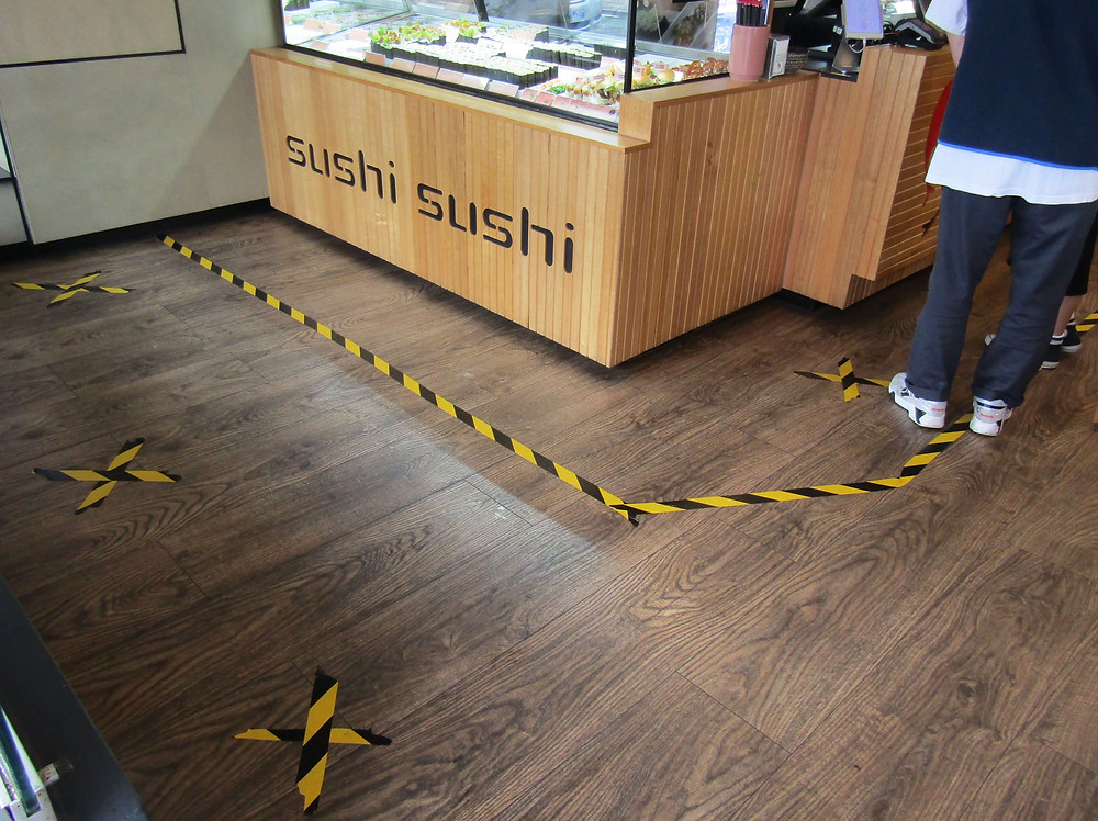 Social distancing tape inside of Sushi Sushi, 700 Glenferrie Road.
