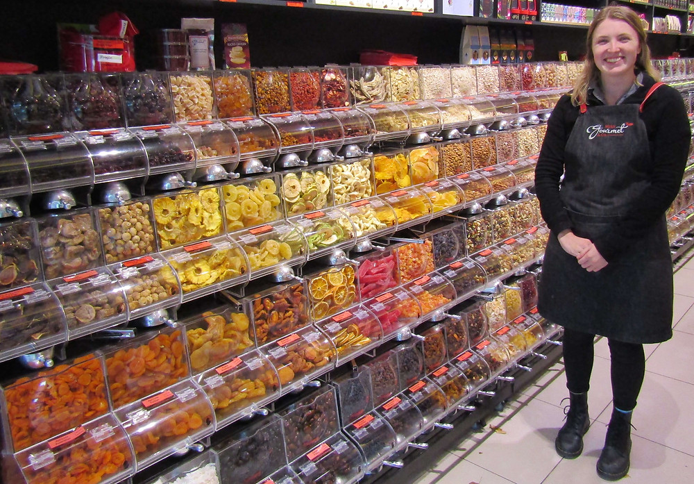 Jordan showing off the bulk foods at Miss Gourmet & Co.