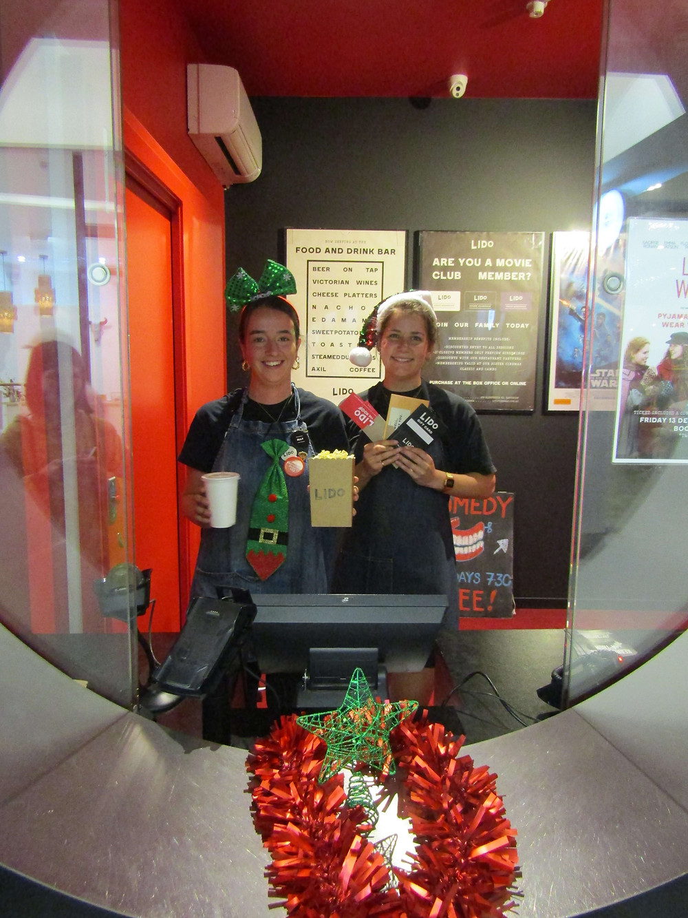 Ally (left) and Coco (right) from Lido Cinemas with gift packs and giftcards - the perfect stocking stuffer.