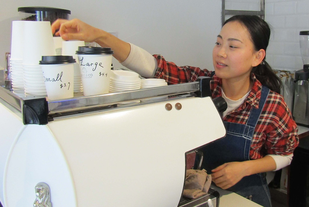 Nicole serving takeaway coffee from Jane and Co., 616 Glenferrie Road.