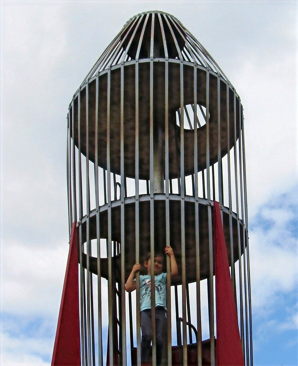 Henry, 4, climbing the iconic rocket at Central Gardens (Rocket Park)