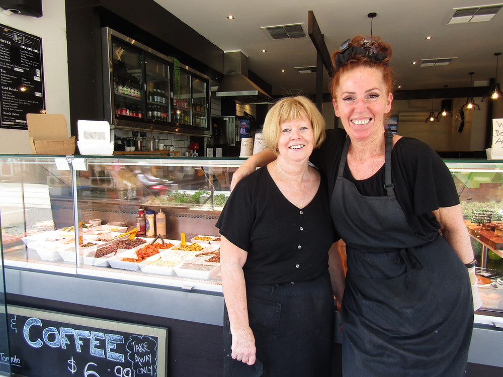 Heather and Cathy of Picasso's Cafe on one of their last days of trading after 16 years, smiling arm in arm.