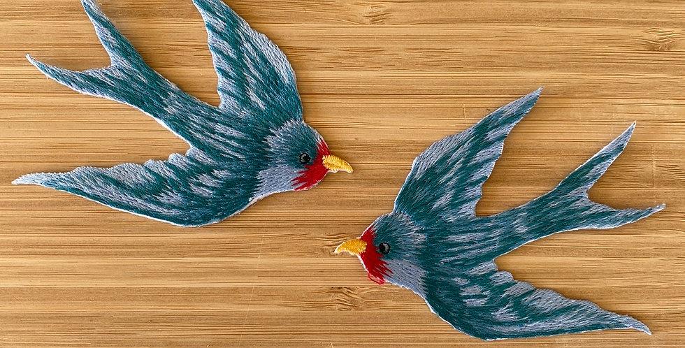 blue swallow motif pair