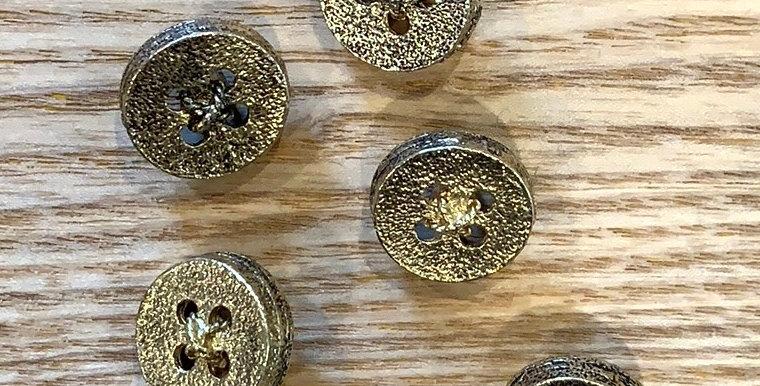 Brass crisscrossed Button