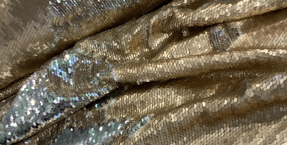 Golden Two Tone Sequin With a Satin Base...