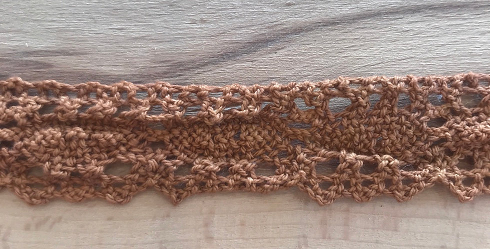 Tan crochet lace