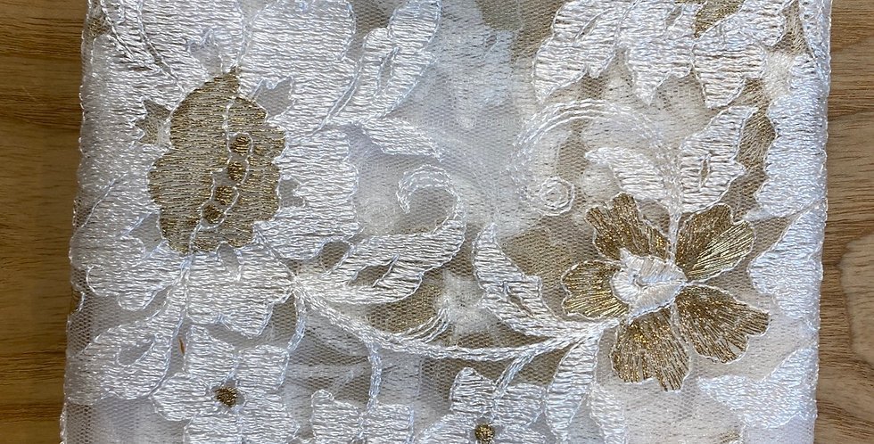 white and gold embroidered lace remnant