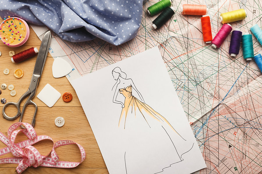 Dressmaking and fashion collection background. Drawn sketches, sewing patterns and various