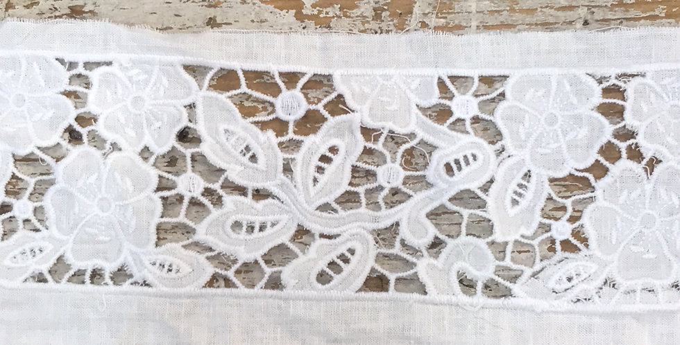 Intricate embroidered linen trim
