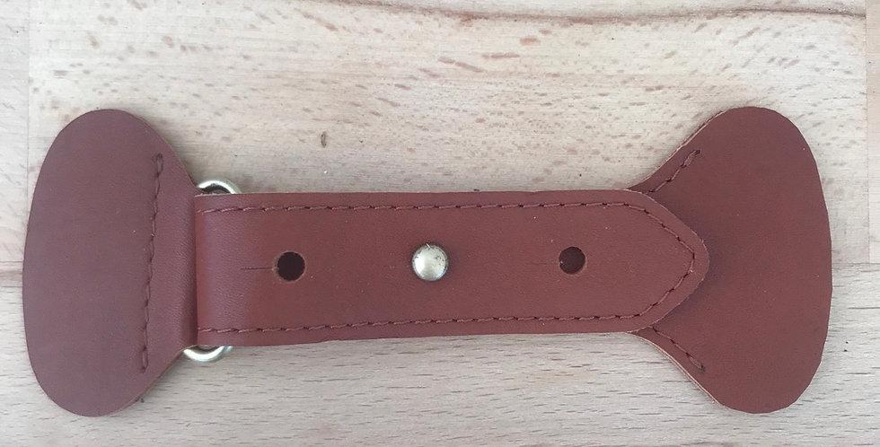 Tan leather belt fastening