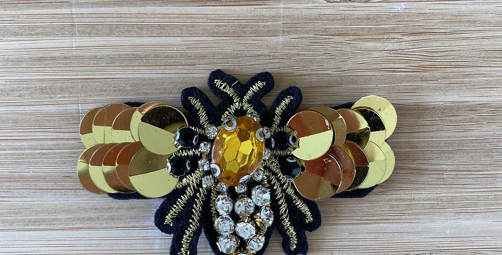 Golden bee motif