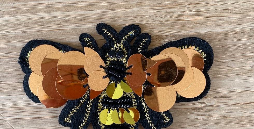 Copper bee motif