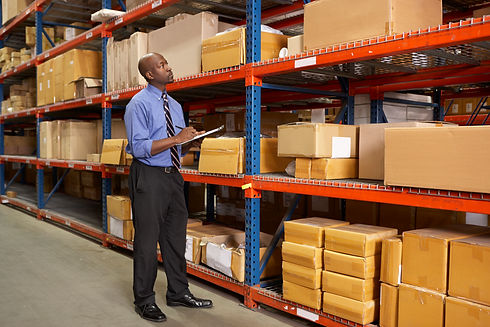 businessman-with-clipboard-in-warehouse-