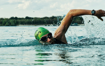 person-swimming-on-body-of-water-1415810