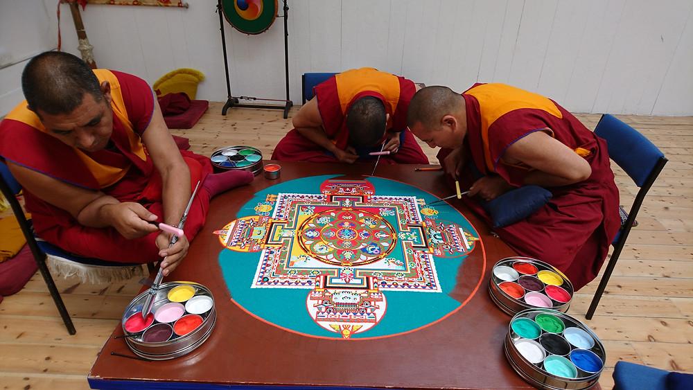 Monks creating the 21 Tara Sand Mandala  http://web.mit.edu/metta/mandala/mandala2009.shtml