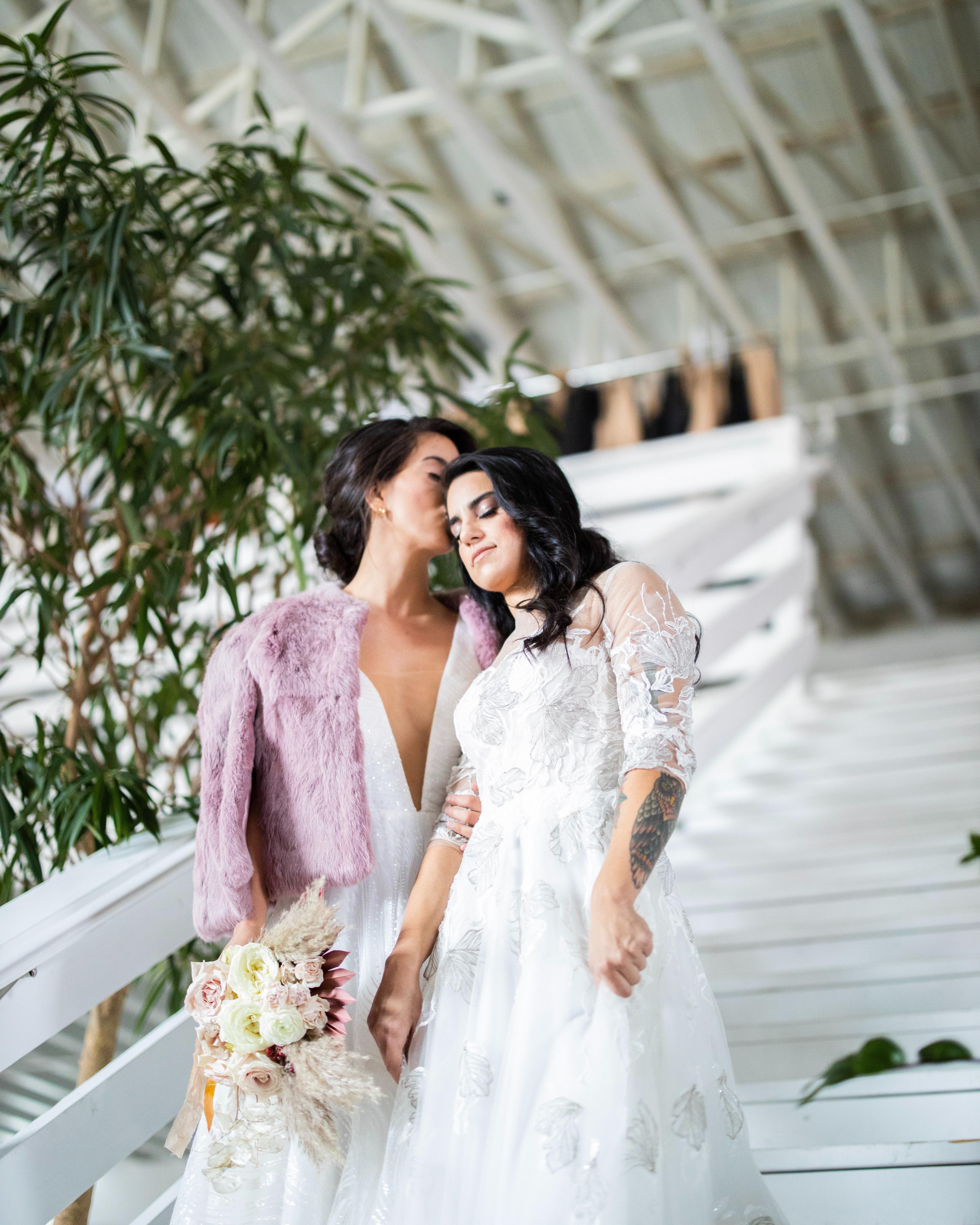 two-women-standing-on-stairway-near-plan