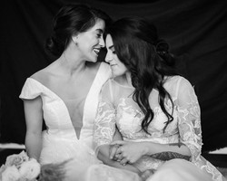 gray-scale-photo-of-two-women-holding-ha
