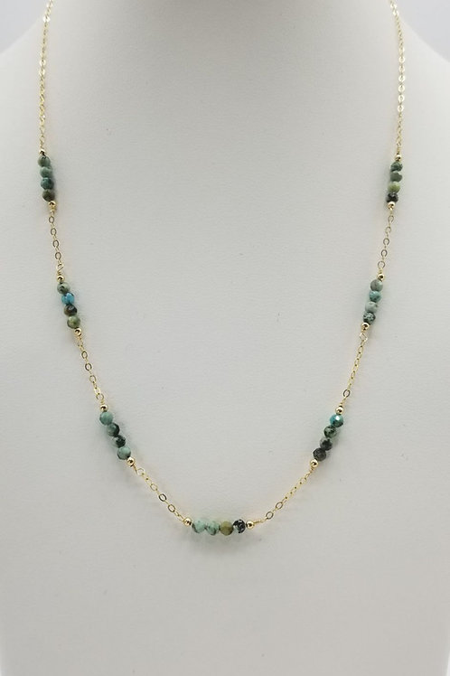 14k gold filled chain with 2mm african turquoise beads.