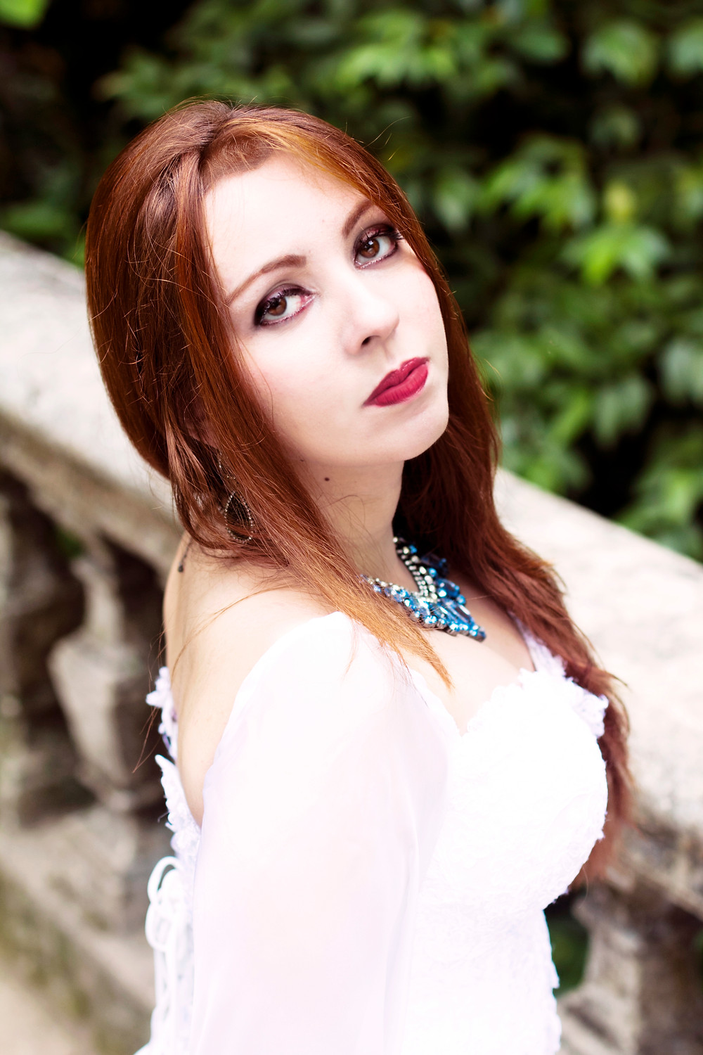 Aline Happ singer of the band Lyria in a white dress
