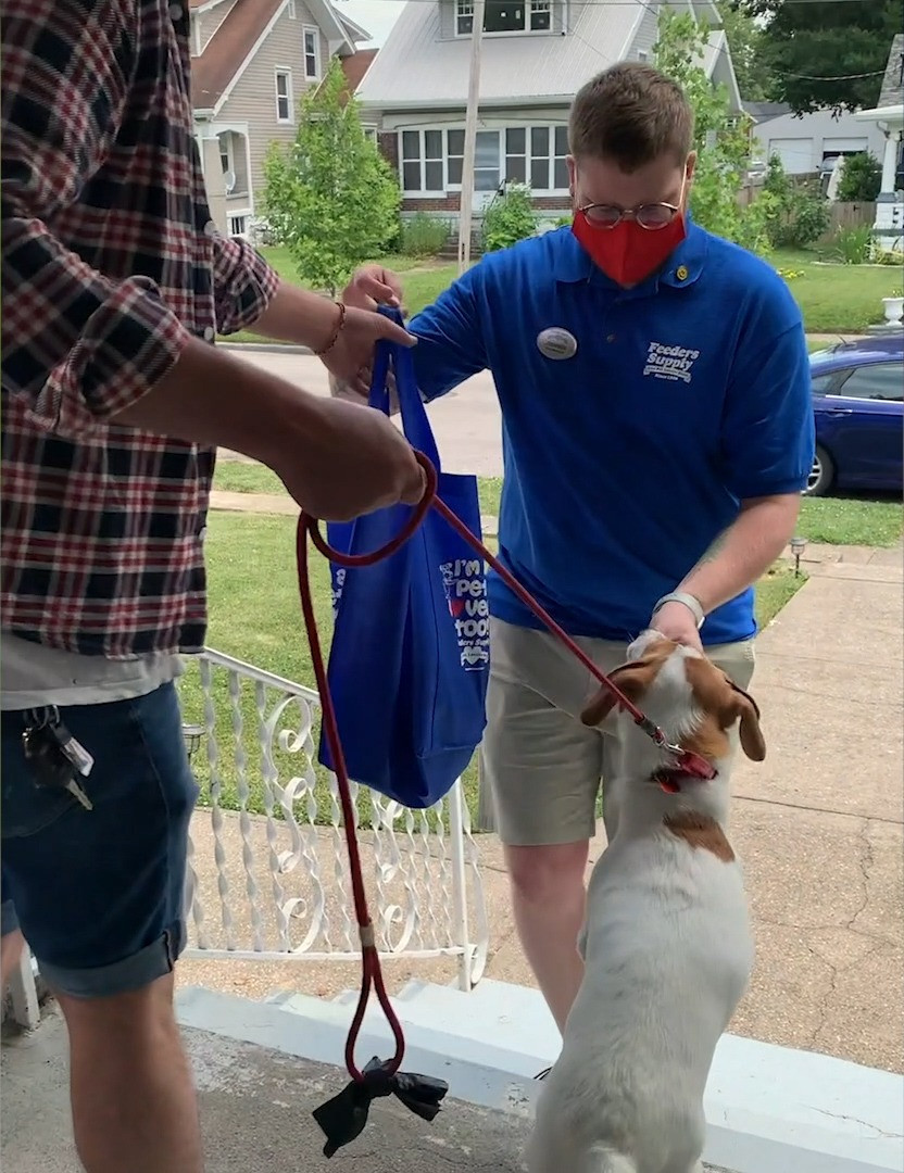 Local feeders supply store associate delivering pet supplies to customer's home