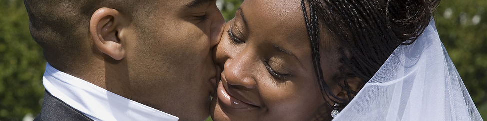 Newlywed african american couple kissing