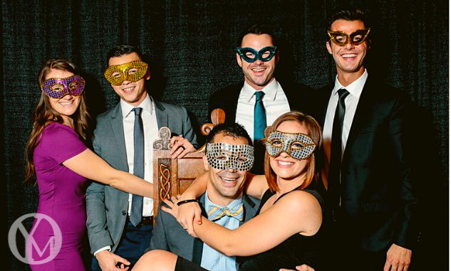 A group of attendees pose for a photo at Odyssey Masquerade.