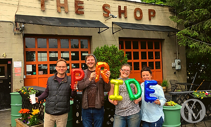 The staff of The Shop pose for a photo at Pride In Perry.