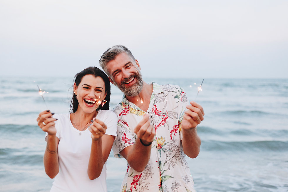 couple-celebrating-with-sparklers-at-the