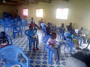 6. Sharing our food with the orphan children at Church For All Nations, Shitoto, Kenya.jpeg