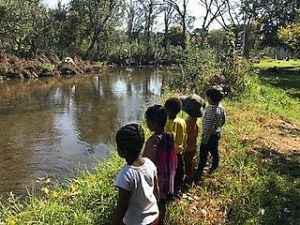 children at a river, benefits of nature for preshoolers