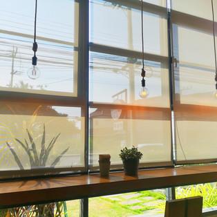 beige sunscreen roller blinds