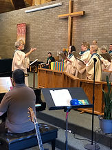 Jane Wester with choir