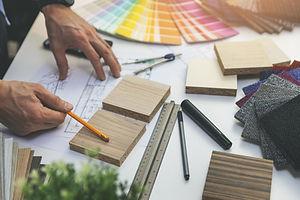 designer choosing flooring and furniture