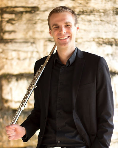 A headshot of James Brinkmann, the Innovative Flutist, with his flute.