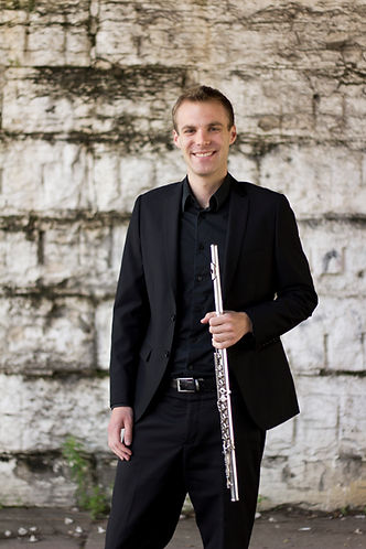 A headshot of James Brinkmann, Innovative Flutist, with his flute on his Connect page. Happy creating!