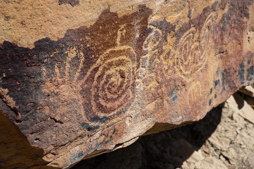 Ancient petroglyphs on a rock wall