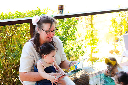 lady reading book to child.jpg