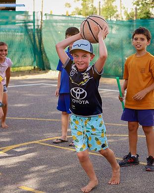 Kids Club children playing basketball.jp