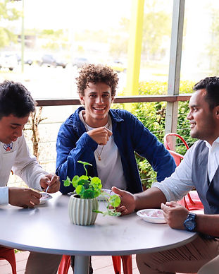 young men eating at table.jpg