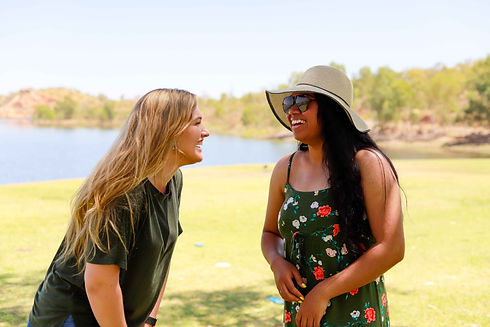 Two young women at lake, laughing
