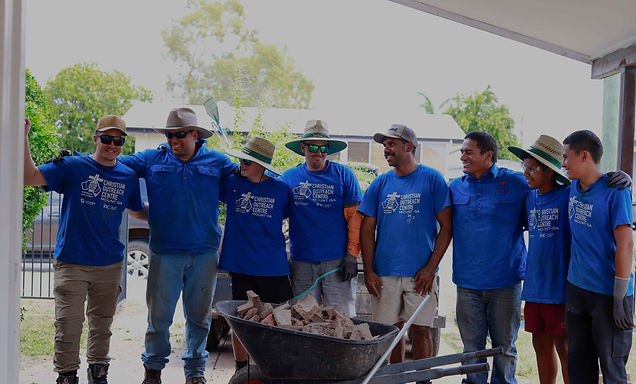 Group of men in blue shirts cropped.jpg