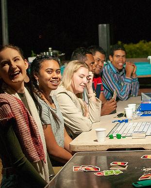 YA groups sitting smiling at table.jpg