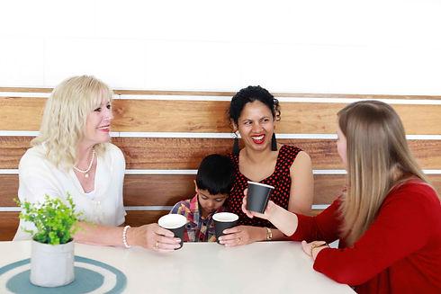 Three women in cafe