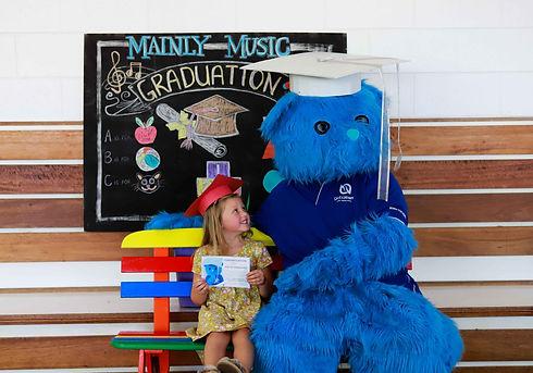 Girl and Bluey at graduation 2.jpg