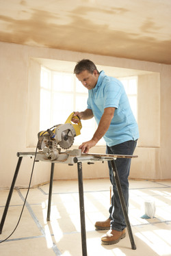 Builder Using Electric Saw