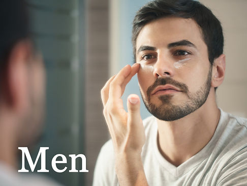 young-man-applying-antiaging-lotion-fot-