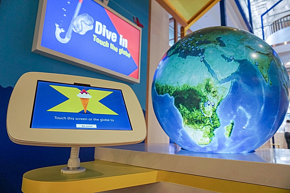 Close up shot of Halifax Bank Flagship digital media display, interactive globe and tablet